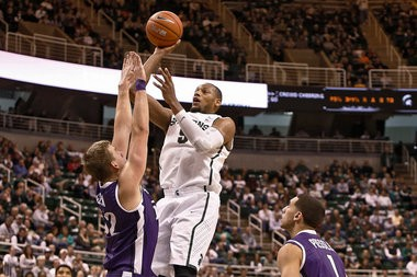Michigan State forward Adreian Payne shoots a jump shot in the second half of their game against Portland on Monday at the Breslin Center in East Lansing. Michigan State won the game, 82-67.