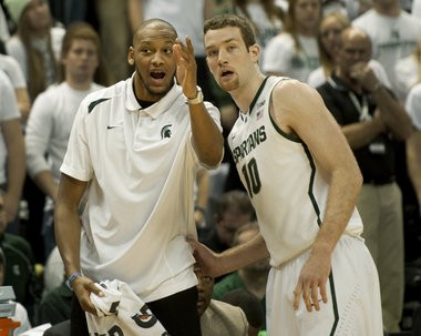 Michigan State's Adreian Payne has spent his time on the bench coaching post players like sophomore Matt Costello.