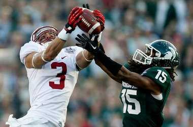 Michigan State cornerback Trae Waynes, right, intercepts a pass intended for Stanford wide receiver Michael Rector during the second half of the Rose Bowl NCAA college football game on Wednesday, Jan. 1, 2014, in Pasadena, Calif. (AP Photo/Danny Moloshok)