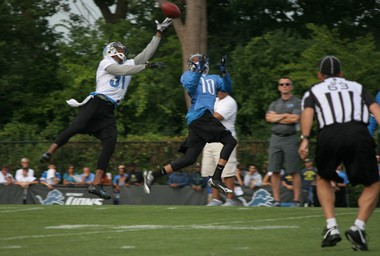 Cornerback Ron Bartell (31) leaps to knock away a pass intended for wide receiver Corey Fuller.