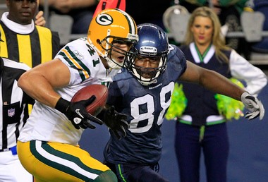 Former Seattle tight end Cameron Morrah, shown vying for a ball with Green Bay's Spencer Havner in a 2010 game, has signed with Detroit.
