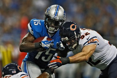 Micheal Spurlock is tackled by Chicago's Blake Costanzo during a game for the Lions earlier this season. He will return to Detroit for the season finale after a stint with Dallas.