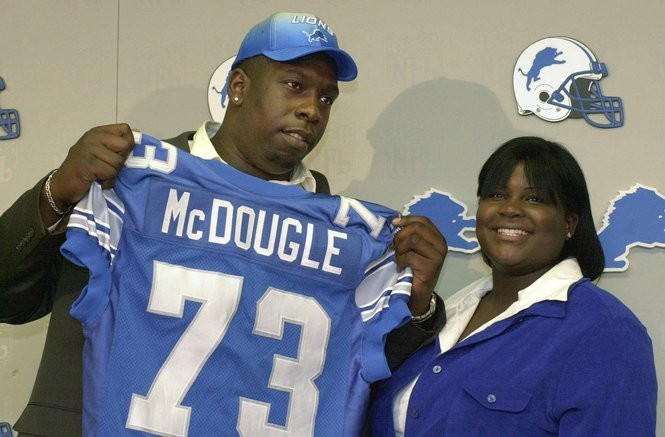 eef6e076f86 Detroit Lions first-round draft choice Stockar McDougle, left, and his wife  Octavia show off McDougle's new jersey at a news conference on Sunday,  April 16, ...