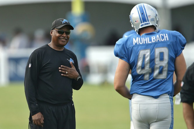 """Lions coach Jim Caldwell, left, says Don Muhlbach is so successful because of """"productive paranoia."""""""