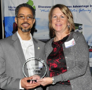 Government sales manager Terence Broussard and president Jane Worthing accept the 2012 Exporter of the Year Award on behalf of Genesee Packaging Inc.