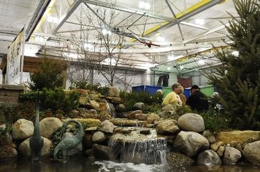 Attendees walk past exhibits at a past Home & Garden Show at Saginaw Valley State University.