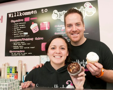 """Adam and Heather Rousseau, owners of SugarHigh Bakery in the RiverPlace Shops, 925 S. Main in Frankenmuth, won $10,000 on an episode of Cupcake Wars that aired on Sunday, Nov. 4, 2012, on the Food Network, defeating three other teams of cupcake makers. In this file photo, they are holding two of the winning recipes, """"Turtle Power, """" left, and """"Cuatro Leches."""""""