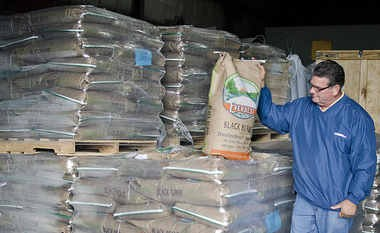 In this file photo, Jim Sattelberg displays a bag of black beans at Everbest Organics.