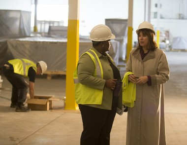 JoAnn Crary, president of Saginaw Future Inc., talks with Ayana Talley, the human resources manager, during a tour through Suniva's new solar panel manufacturing facility in Saginaw Township, Sept. 30, 2014.