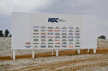 In this October 2010 photo, a sign at the site of Hemlock Semiconductor's Clarksville, Tenn. site shows all the contractors associated with the $1.2 billion project.