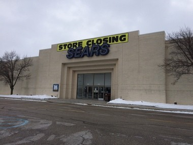 """""""Store closing"""" signs are posted outside the Sears store at the Bay City Mall Thursday, Jan. 8, 2015."""