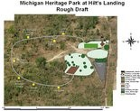 A slide shows the site plan for the trail and exhibits at Hilt's Landing Michigan's Heritage Park, set to open in Spring 2015.