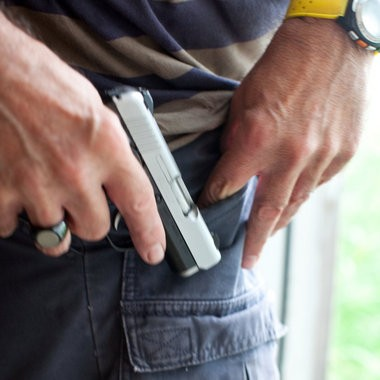 Mike Bernethy, instructor of the CPL certification course, demonstrates how inconspicuous a concealed weapon can appear.