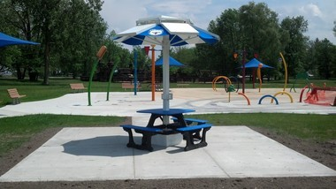 "The solar powered table is located near the ""Spray By the Bay"" Splash Park at the Bay City State Recreation Area in Bangor Township."
