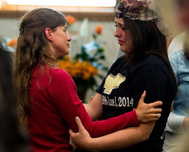 Patrice LaLonde talks with friends at the conclusion of her son'sfuneral service Wednesday, June 4, at Rivertown Funeral Chapel, 209 S. Huron Road in Kawkawlin Township. Ryon LaLonde died Sunday morning in a single vehicle crash. (Yfat Yossifor | The Bay City Times)