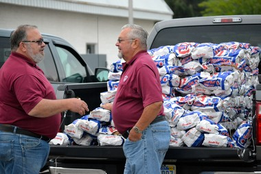 Munger Volunteer Firemen hand out 5-pound bags of potatoes and chips at Firehouse Soft Car Wash, 2921 Center Ave. in Essexville, on Tuesday, July 15, in preparation of the 60th annual Munger Potato Festival that runs July 24-27.