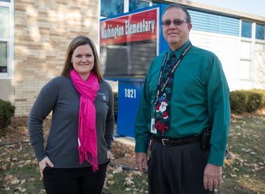 Jodi Wrzesinski, 4-H program coordinator for MSU Extension in Bay County, and Bill Tithof, principal at Washington Elementary School.