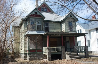 A property at 407 N. VanBuren St. in Bay City, owned by Steven Ingersoll, has its windows boarded up.