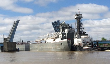 The tug Manitou pulls the freighter Lewis J. Kuber past Veterans Memorial Bridge toward Saginaw in this photo from May 2014.