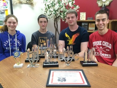 The Rise of the Warrior Bots, Bay City Western High School's robotics team, has had an especially decorated rookie season. Pictured, from left: Katelyn Doud, Craig Ziehmer, Jason Bannister and Nicholas Jacobs, all members of the team.