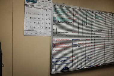 A white board at Dore and Associates keeps track of the demolition company's current bids.