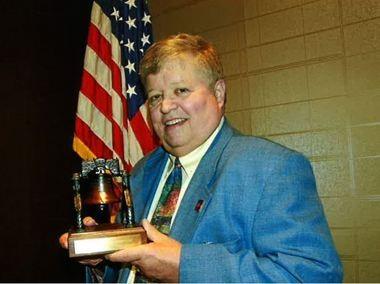 Thomas A. Matuszewski holding the Liberty Bell Award