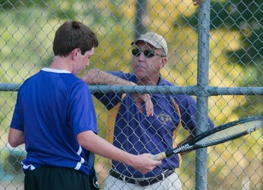 Bay City Central's sophomore Ryan Vincent talks with head coach Joe Ricard during a tennis match against Midland High Tuesday, Sept. 4, 2012 at Carroll Park in Bay City.