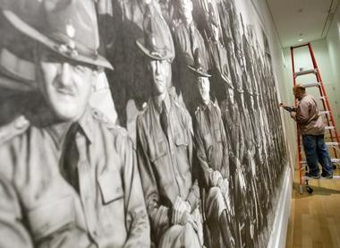 """Chris LaPorte, the Bay City native who won ArtPrize in 2010, takes down his work """"Calvary, American Officers, 1921"""" at the Grand Rapids Art Museum Friday, August 8, 2011."""