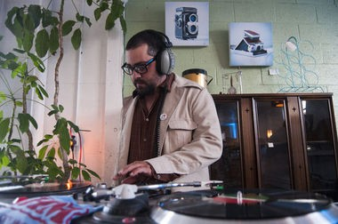 """Brendon """"Deon"""" Baranek plays music at Retro Attics during the Hell's Half Mile Launch Party Thursday, Aug. 13, 2015 in Bay City."""