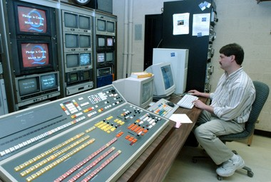 Broadcast technology has come along ways since this photo of Q-TV producer Marshall Fulmer was taken in 2003. The industry is about to embark upon an unprecedented spectrum auction and finalize a new transmission standard.
