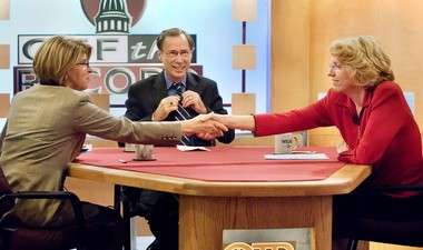 In this 2006 photo, Michigan Secretary of State Terri Lynn Land, right, shakes hands with Democratic challenger Carmella Sabaugh following a debate on WKAR, the public television station owned by Michigan State University.