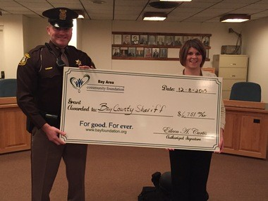 Bay County Sheriff's Deputy Art Kleinert with Lisa Cleland from the Bay Area Community Foundation.