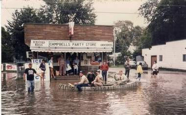 A crowd rows up to Campbell's Party Store, at Frank and Elm streets on Bay City's West Side.