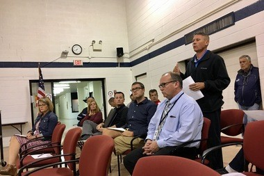 Bangor John Glenn boys varsity basketball coach Dale Clyde speaks against joining the Saginaw Valley League at a school board meeting Monday, Oct. 10.