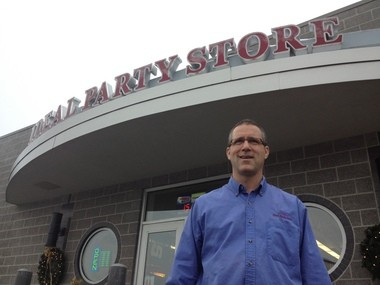 Jerry Crete stands in front of Ideal Party Store, 410 Salzburg Ave. location on Dec. 19, 2013.