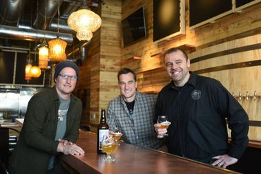 Northern United Brewing Co. Co-founders and co-CEOs Jon Carlson and Greg Lobdell and CEO Tony Grant pose for a photo inside the new Jolly Pumpkin location in Detroit.
