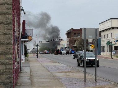 Dark smoke fills the sky above a house fire Sunday, May 6, 2018, in the area of Salzburg Avenue and Warner Street in Bay City.