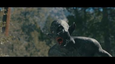 "Alan Maxson in costume as a creature in the 2017 film ""The Woods."""