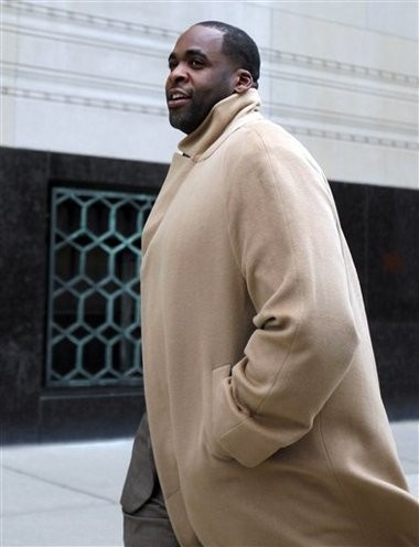Former Detroit Mayor Kwame Kilpatrick makes his way to federal court in Detroit, on Monday, Feb. 11, 2013. Kilpatrick, 42, is charged with 30 crimes, including bribery, racketeering conspiracy, extortion and tax violations. ANDRE J. JACKSON/Detroit Free Press (AP Photo/Detroit Free Press, )