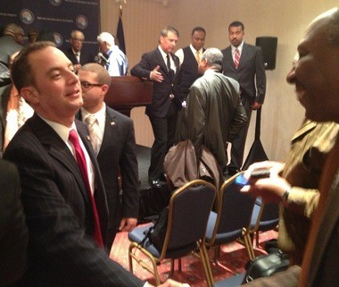 """Reince Priebus speaks with reporters Tuesday ahead of a meeting with black community leaders at the Renaissance Center in Detroit. He said he wants to build a long-lasting, """"block-by-block"""" GOP outreach apparatus in Michigan."""