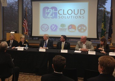 Representatives of Genesee, Livingston, Oakland, Macomb and St. Clair counties announce teaming up to cut costs and improve online services by forming a technological network called G2G Cloud Solutions in a Nov. 20, 2013 press conference in Waterford.