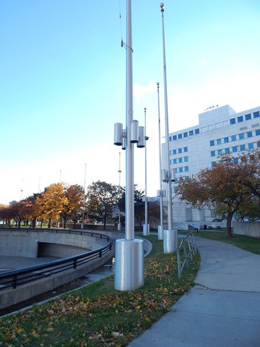 A Grosse Pointe Woods man is leading an effort to restore 20 tall, defunct flag poles at Detroit's Hart Plaza.