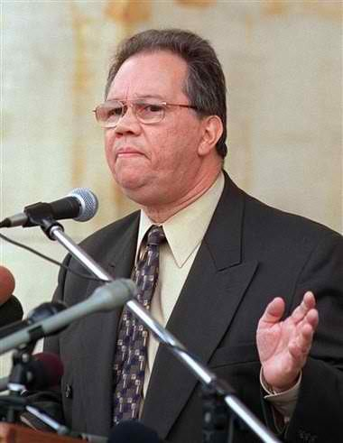 In this AP file photo photo taken Sept. 23, 2002, then city water director Victor Mercado speaks during a news conference at the Water Works Park in Detroit.