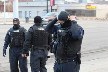 Detroit police during a March 2014 raid. The state House Criminal Justice Committee on Oct. 1 will hear testimony on a bill that would require police agencies to do more public reporting on SWAT team activity.