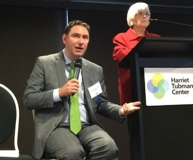 "Jason Jordan, executive director at the Center for Transportation Excellence in Washington, D.C. speaks at the ""Build Transit, Build Business"" summit at Ford Field in Detroit Tuesday, Nov. 18."