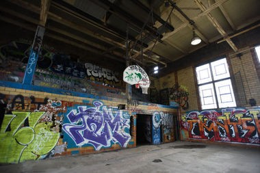 Colorful graffiti covers the walls inside the Brewster Wheeler Recreation Center in Detroit.