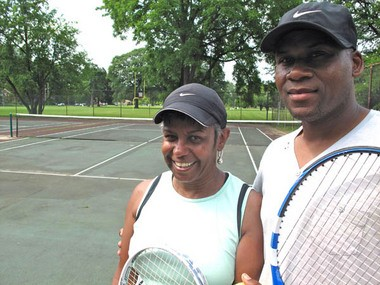Debbie Kent and Ronald Parker have been playing tennis for 30 years at Stoepel Park No. 1 on Detroit's west side. (Bridge photo by Bill McGraw)