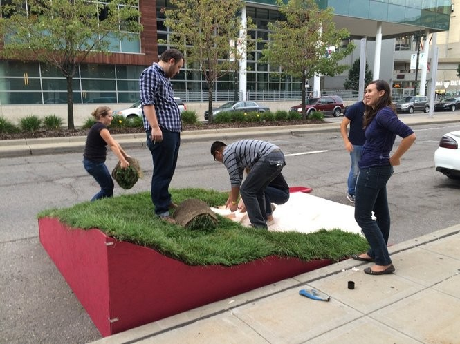 Designers and volunteers with RogueHAA build a temporary park in a metered parking spot in Downtown Detroit on Sept. 19, 2015 as part of Park(ing) Day 2015.