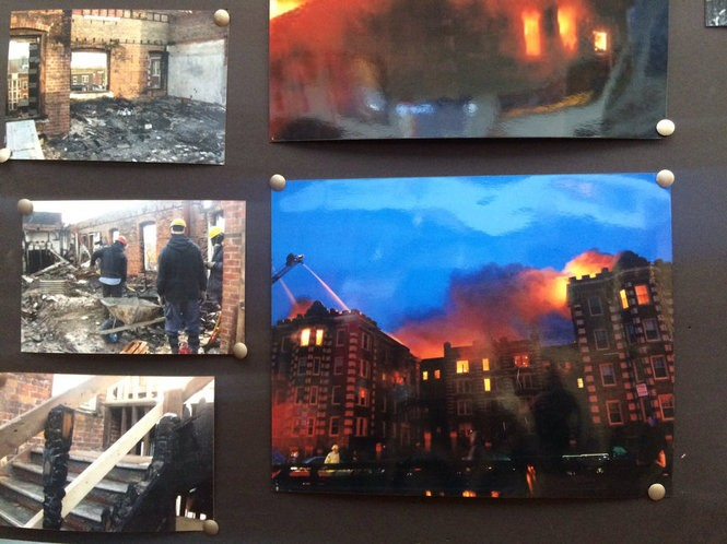Photos tacked up on a bulletin board show the 2008 fire that heavily damaged the building.