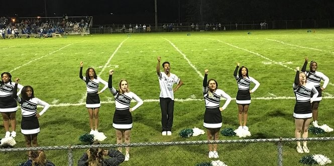 East Detroit High cheerleaders pepped up the crowd at a recent football game versus Lakeview High, a school in St. Clair Shores. East Detroit Schools have become majority African American as more black students enrolled as many of their white classmates now attend school in St. Clair shores. (Bridge photo by Chastity Pratt Dawsey)